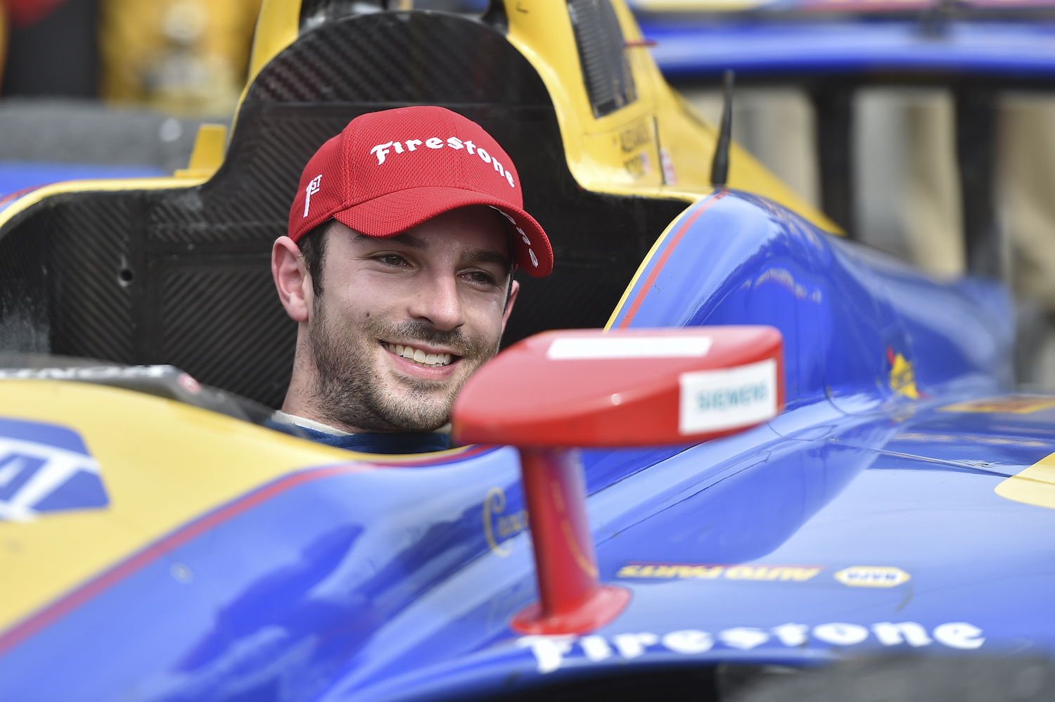 Alexander Rossi is all smiles in Victory Circle after winning the Toyota Grand Prix of Long Beach