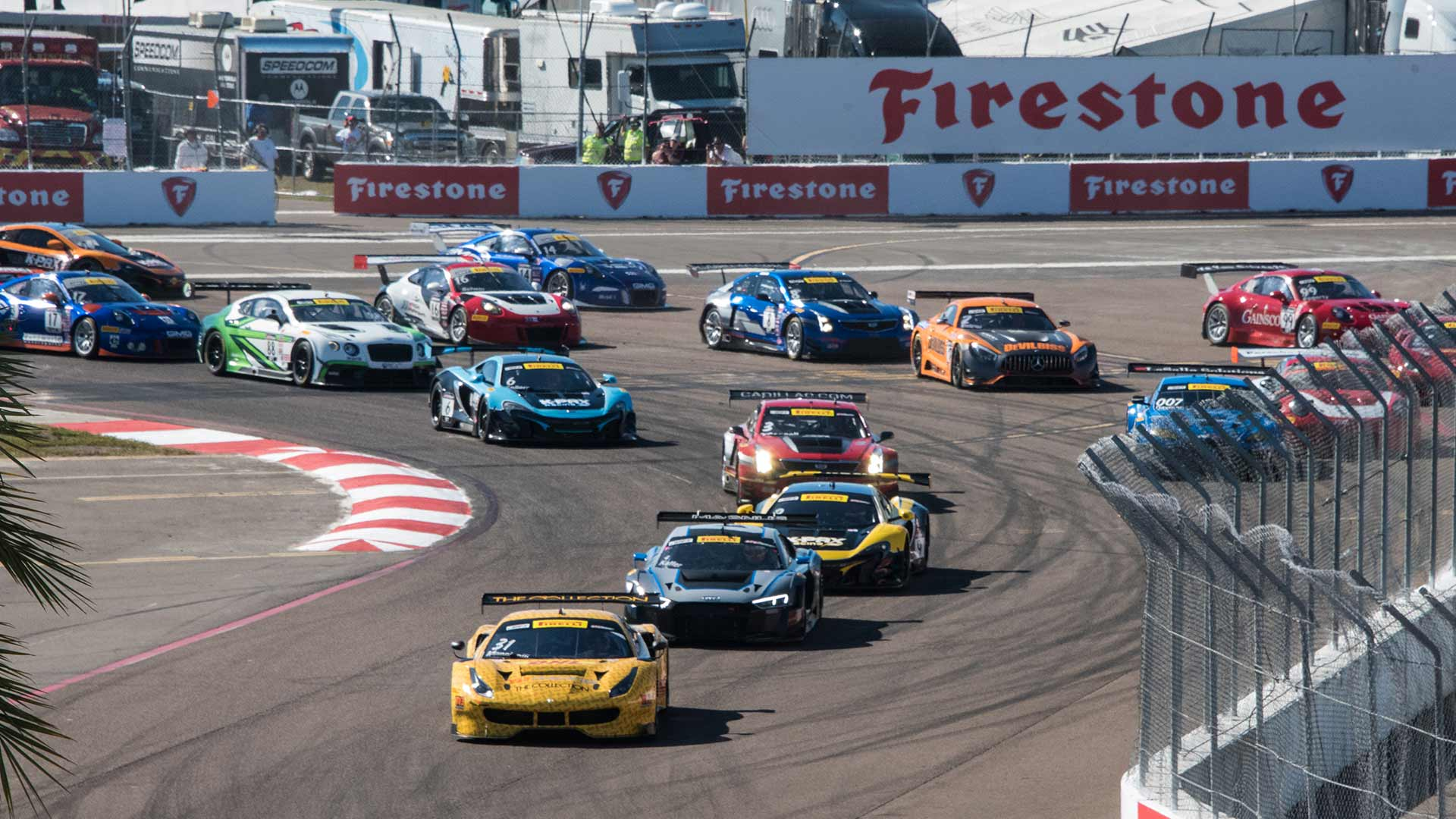Pirelli World Challenge cars speeding through turn 1 at the Firestone Grand Prix of St. Petersburg