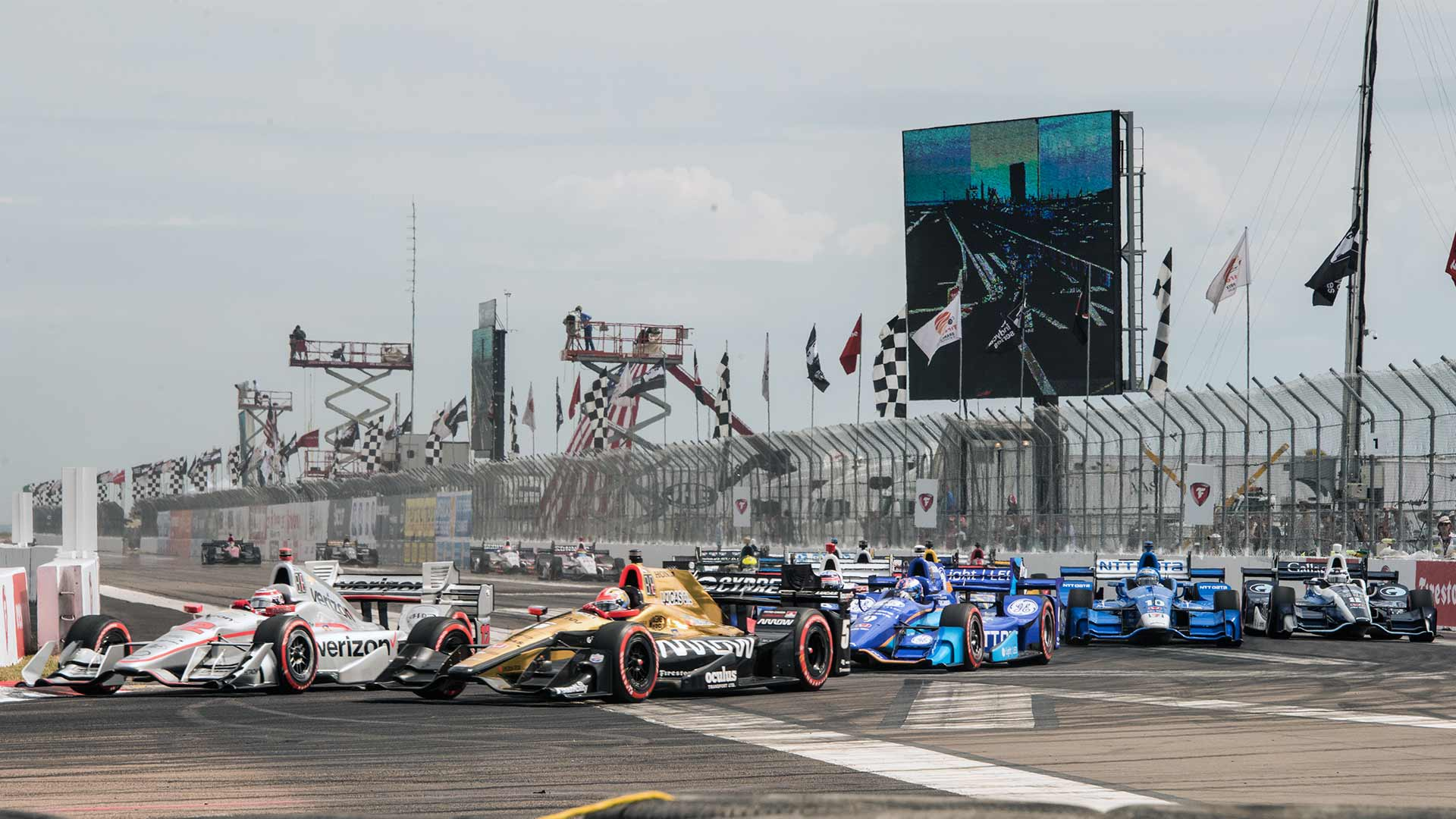 IndyCars speeding into turn 1 at the Firestone Grand Prix of St. Petersburg