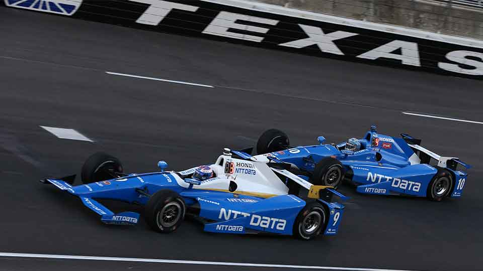Scott Dixon and Tony Kanaan on track at Texas Motor Speedway